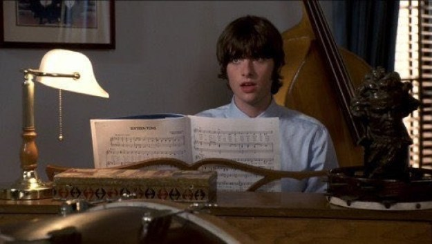1) He had adorable floppy hair and bangs that made him look like the fifth Beatle: