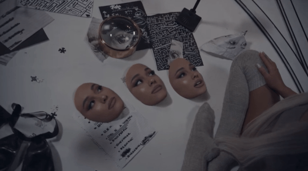 However, there are a couple of other interesting details which might give us some clues about her upcoming album. Going back to the scene with the masks, it's interesting to note that there are three, perhaps representing each of her past albums.