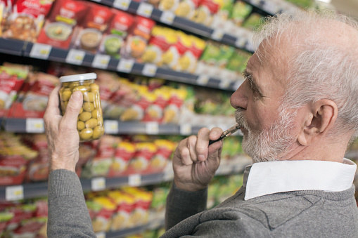 And lastly, an old man looking at olives...vaping.