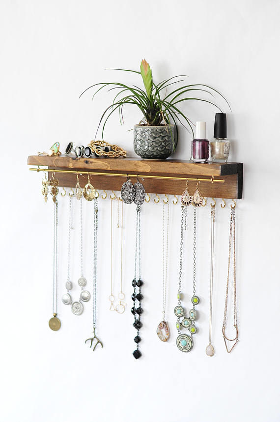 It also has an elegant rod for hanging earrings!Get it from The Knotted Wood on Etsy for $40+ (available in four sizes and 10 colors).