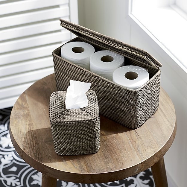 """It's also super helpful for guests to leave TP out so they don't have to rummage through your house looking for some just to do their business. Promising review: """"I bought this a month ago to hold extra toilet paper out of sight in the bathroom. I selected the grey color to compliment the silver accents. The basket is small enough to sit on top of the commode, but large enough to hold two extra large rolls of toilet paper, extra hand towels, and a little bottle of those toilet bowl freshener sprays. It's perfect for my tiny hall bathroom!"""" —Teri71Get it from Crate and Barrel for $29.95 (available in three colors)."""