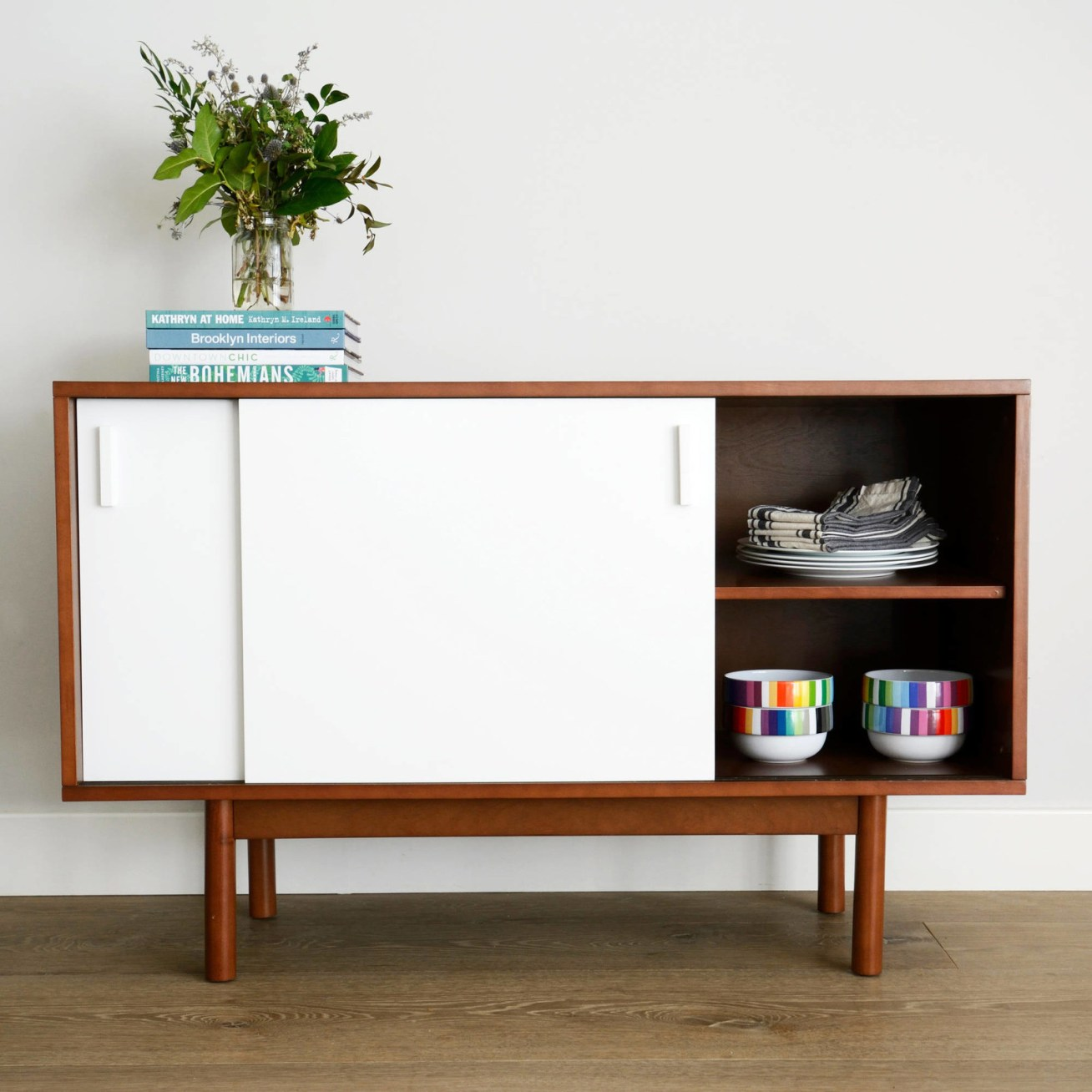 "Promising review: ""I thought I would have to spend 0+ on something that would satisfy my needs, but not really the look I wanted. I was thrilled when I came across this credenza for far less than 0. I am a 50-year-old woman and put this together by myself in much less time than other projects I've tackled. This credenza is very sturdy and offers a lot of useful storage space for the size. I love the clean, simple look that blends well with a large wood daybed and brass and glass desk I have in the same room. If you are looking for a very functional piece of furniture at an extremely low price, don't hesitate to take a chance with this. It will not disappoint!!"" —BethPrice: 9.98"