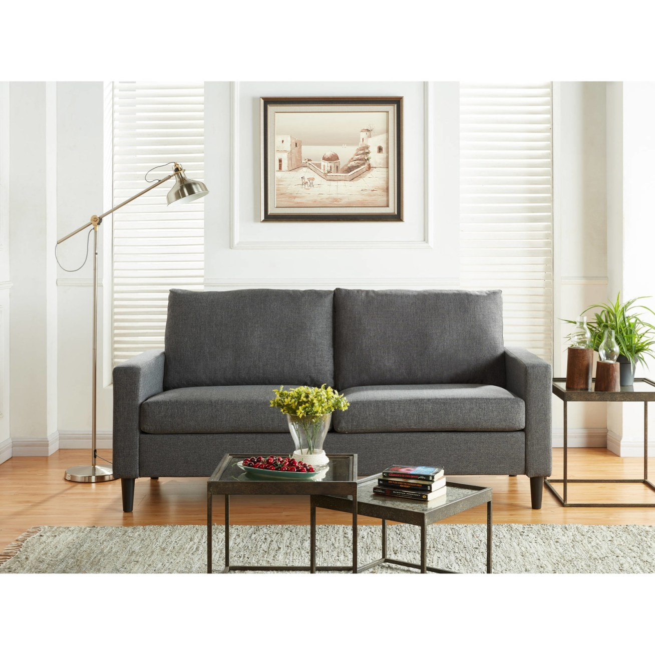 "Promising review: ""The sofa is very attractive, modern, and sleek. We bought it for our wine bar/lounge TV room and it's not too big, not too small — the perfect size for a party of three (hubby, dog, and me). My giant schnauzer was already trying to take ownership of it even before it was fully assembled! My husband likes the firmness and support of the cushions. It seems like it will hold up well over time. Be sure to read the assembly instructions carefully and you will not have any issues. You cannot beat the great value of this sofa. It looks a lot more expensive than it is. Thank you, Walmart!!!"" —StellasMumPrice: 9"