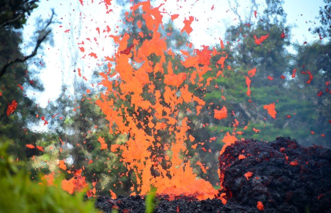 Lava erupts from a fissure.