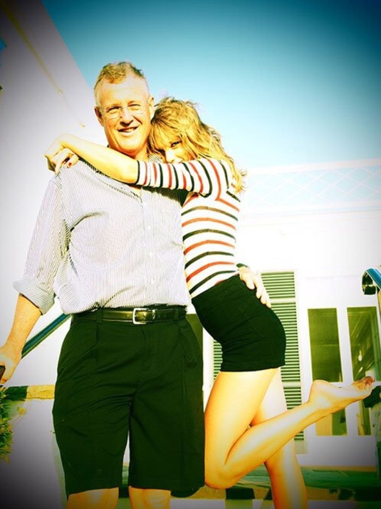 LIKES TO PARTY. Here he is at Taylor's iconic Fourth of July party: