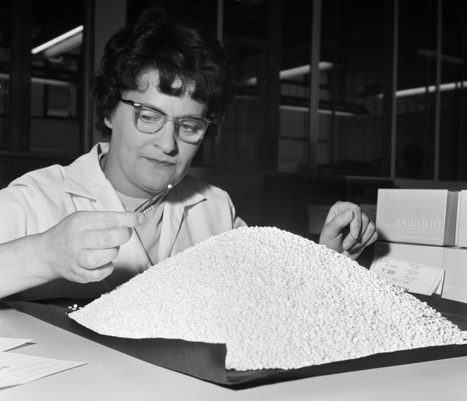 A pharmacist sorts 150,000 Volidan birth control pills in London on Aug. 17, 1965.