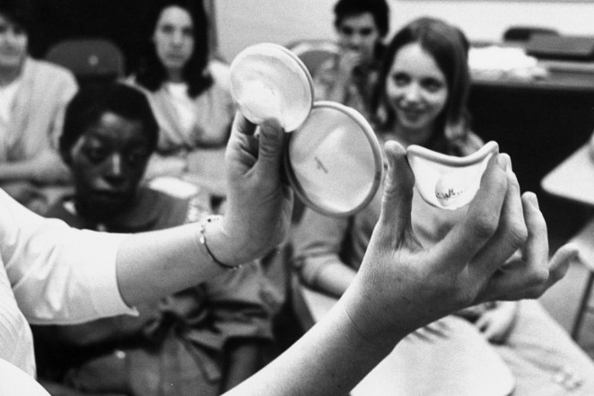 A nurse teaches a group of young women how to properly use a diaphragm contraceptive in 1967.
