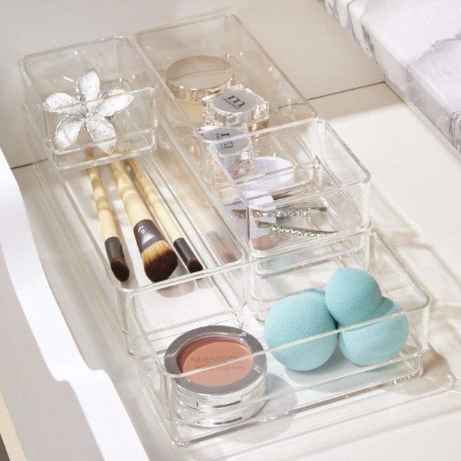 "Promising review: ""This set is exactly what I've been looking for. They fit perfectly in my drawers, and stacked they are the exact depth of the shallow drawer in my vanity. Perfect for organizing all the small tools and bits of makeup, bottles of perfume and tubes of medicine etc. Appear to be heavy/high quality enough to last a long time."" —S. KnoxGet the set on Amazon for $14.99."