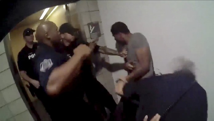 This still image taken from a body-camera video on May 23 and released by the Mesa Police Department shows officers beating Robert Johnson.