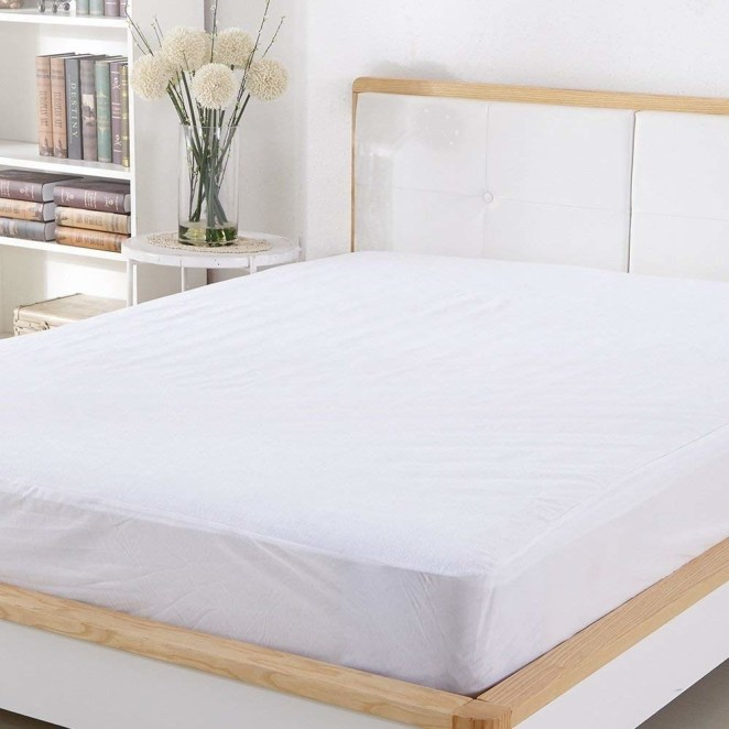 "Promising review: ""Love this thing! Spend a little money on the good stuff like this! It helped during a recent spill, and the mattress was completely untouched. The quality of this protector is AMAZING! Noiseless and beautiful."" —NancyGet it from Amazon for $15.99+ (available in three sizes)."