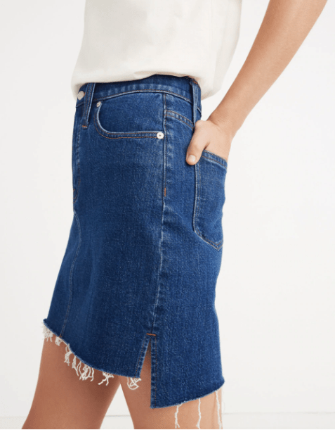 """Promising review: """"I have a problem with frayed denim skirts — a consistent problem that my phat derrière gets me into after I wash my skirt a couple times. This one has just enough length in the back and stretch for those moments when I can use the extra breathing room."""" –LeenybewtyGet it from Madewell for $59.50 (originally $85, available in sizes 23-32)."""