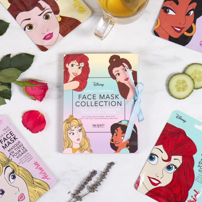 the Disney princess face mask collection from Firebox spread out and styled on a table