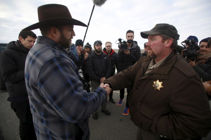 Ammon Bundy (L) meets with Harney County Sheriff David Ward along a road south of the Malheur National Wildlife Refuge near Burns, Oregon, January 7, 2016.