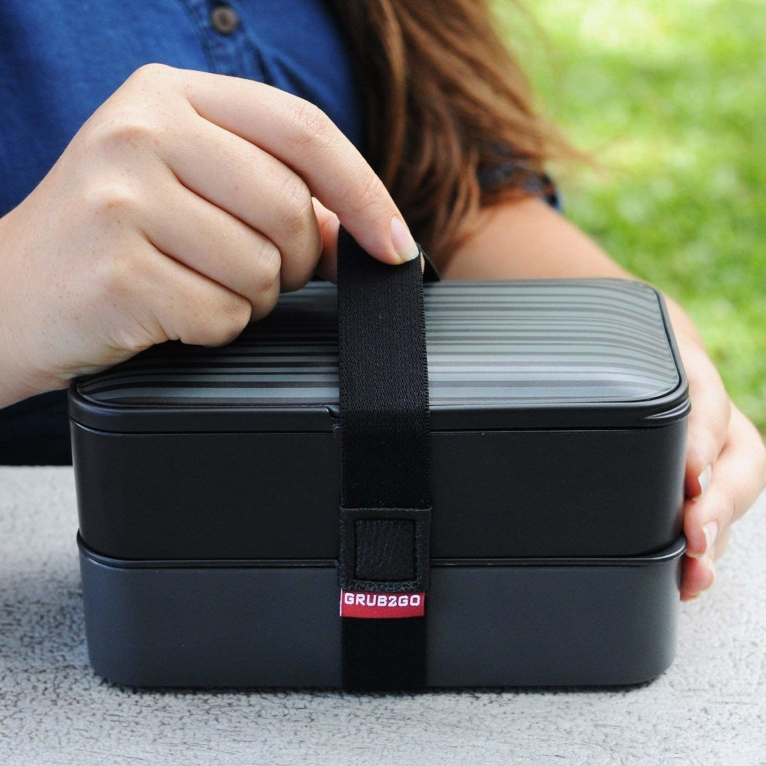 "Promising review: ""This bento box is perfect for what I need. Instead of bringing several containers to work each day, I just bring this. It's great that I can have a hot meal for future heating in one section and cold food items in the other. Each section is sealed airtight — no leaking. They heat up in the microwave easily. The little air vent helps with reheating. They clean up super easy with soapy water. Well made. Fairly stylish. Great product."" —Chuck GhouliePrice: $21.95"