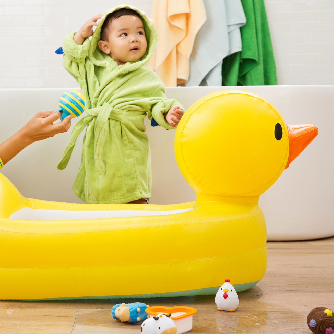 """We have a feeling this will make bath time ~so much fun~...Promising review: """"My son LOVES this tub! He can sit propped up on the side and play without me having to hold him up the whole time. He loves the quacking, and I love the built in water thermometer. I also love that after bath time, I can drain it with ease and stick it to the wall with the very convenient suction cup on the bottom, leaving plenty of room for someone else to use the bath or shower!"""" —firethearsonPrice: .95"""