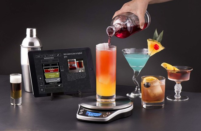 The Perfect Drink app allows you to choose a drink recipe and serving size. You then place a glass — or the included shaker — on the scale to begin your drink-making experience. The scale automatically weighs ingredients as you pour and lets you know when you need to stop pouring each ingredient.