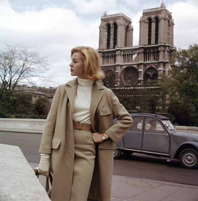 A model poses in front of the Catherdral of Notre Dame.
