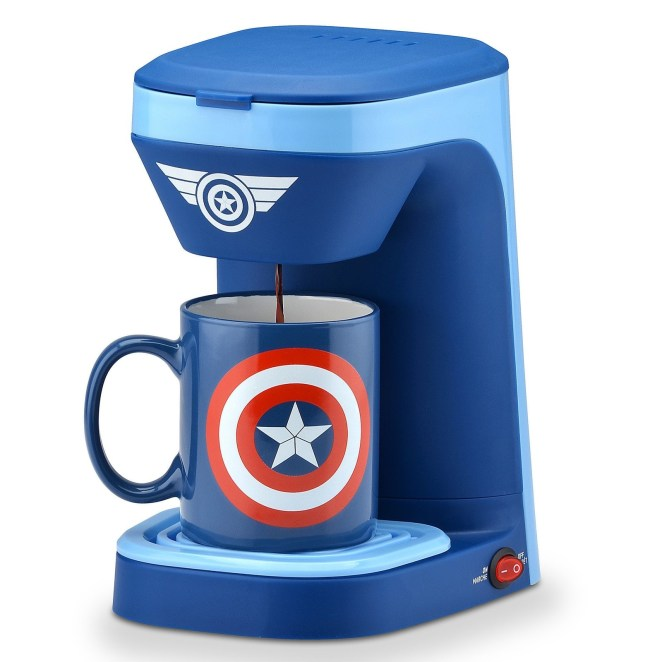 The mug is included! This coffee maker brews one cup of coffee at a time. The filter basket and drip tray are removable for easy cleaning. It has a 14-ounce water reservoir. Get it from the Disney Store for $24.95.