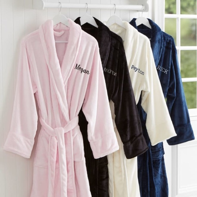 "Promising review: ""These robes are so plush and soft; they feel wonderful on your skin. They are are warm and thicker than many hotel and spa robes. They also wash well and don't pill; the fleece retains its softness and shape. The only thing I wish it had was a hood. It's a quality item at a reasonable price."" —Kellie R. Get one from Personalization Mall for $48.99 (available with either names or monograms; one size fits up to XL; four colors)."
