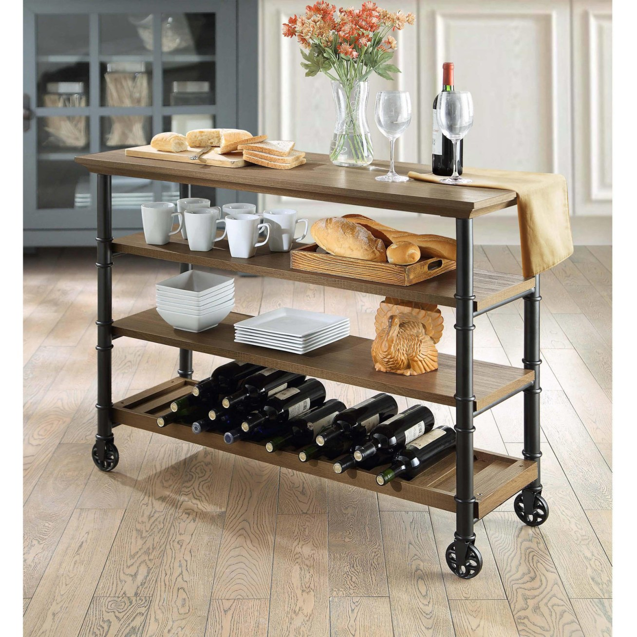 "Promising review: ""I have two of these and bought them specifically to help free up some of the cabinet space in my kitchen and to store wine. It is a solid, quality piece of furniture and adds a nice industrial-rustic quality to the space. The finish on both the wood and metal pieces are smooth. Although the feet are circular, they are not wheels and do not move. The bottoms of the feet are actually sufficiently flat, making for a stable stand. It was quite easy to put together, taking less than 25 minutes. All-in-all, it's a great design and I couldn't be happier with it."" —HoustonStrongPrice: 9"