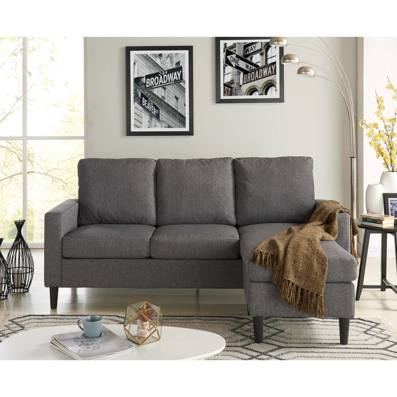 "Promising review: ""I love my couch! I had it for two months. At first, it was a little uncomfortable like an office couch but after awhile it starts to break in. It's the perfect size for a 400 square feet studio apartment. I wanted something small but with a lot of seating and I got it with this perfect little sectional. If you're just starting out I would recommend it because it's affordable, trendy and with some accent pillows you can achieve that comfort you need to relax."" —MariahPrice: 9"
