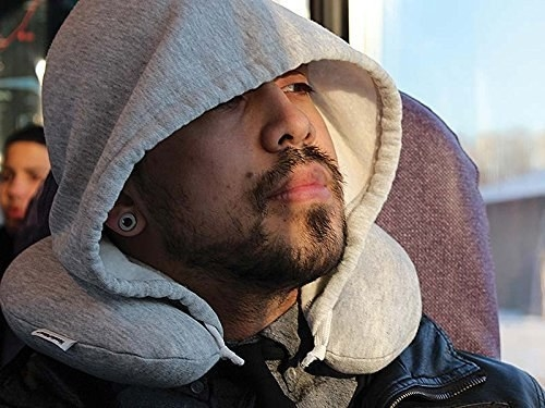 "Promising review: ""Comfortable neck pillow. Great for air travel, the hoodie is very easy to adjust over your face, it helps me block out the unwanted light and overall sights on the plane! I also use when riding as a passenger in a car to get in a quick nap. The memory foam is quite comfortable."" —TKGet it from Amazon for $29.95 (available in four colors)."
