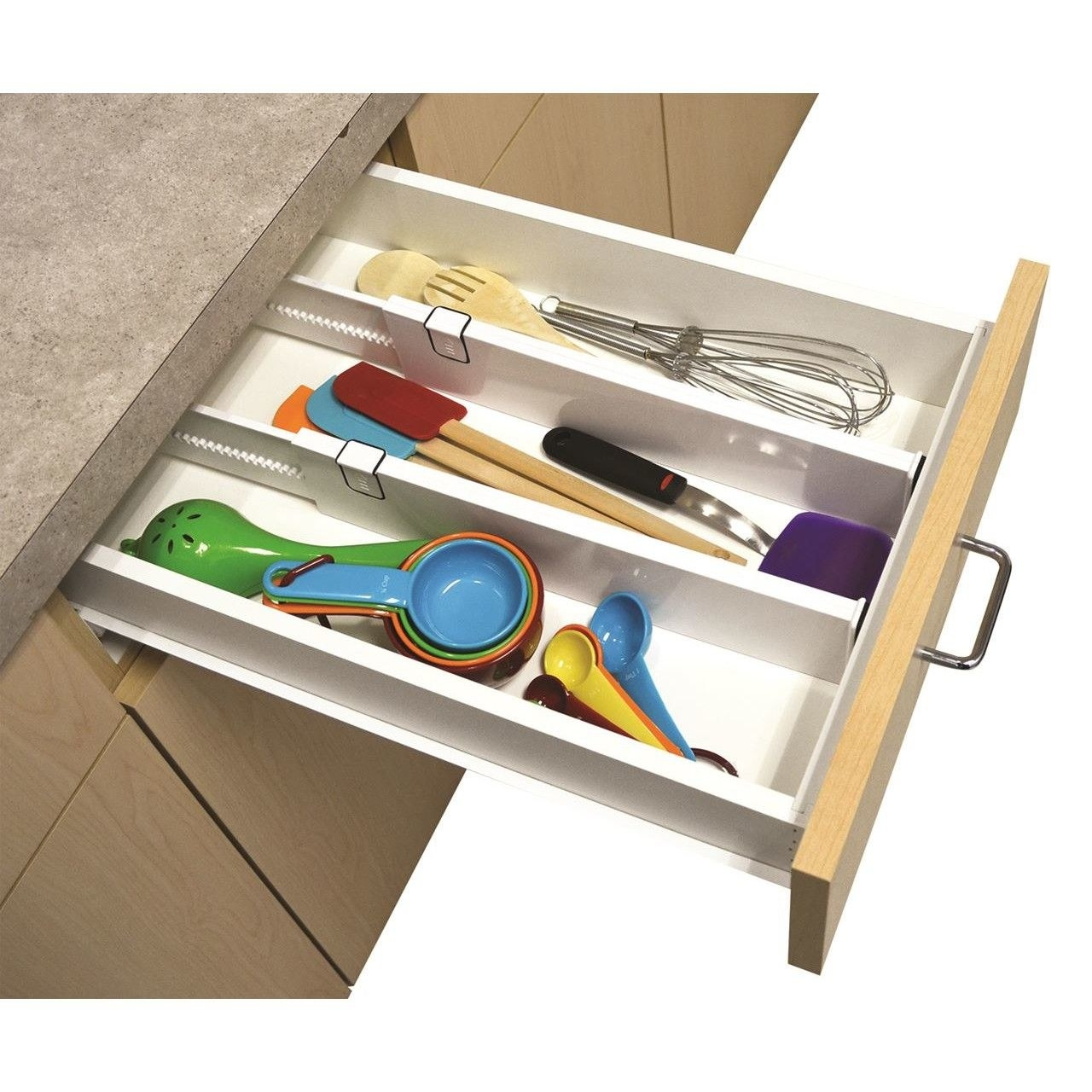 "The dividers expand from 14"" to 21"" and feature non-slip grips on their sides. Promising review: ""It fits right into your drawer and lets you use all the space of the drawer."" —Greco