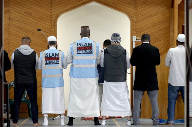 Muslims offer prayers inside the Al Noor mosque, one of the mosques where 51 people were killed by a white supremacist gunman in Christchurch, New Zealand.
