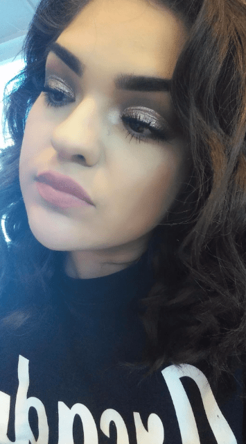 Reviewer with very pigmented, glittery eyeshadow on