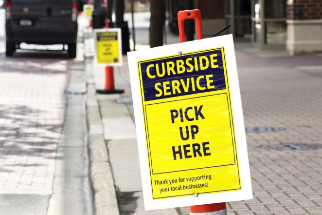A curbside pickup sign