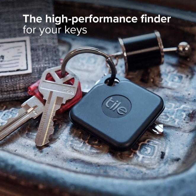 a black tile tracker on a set of keys