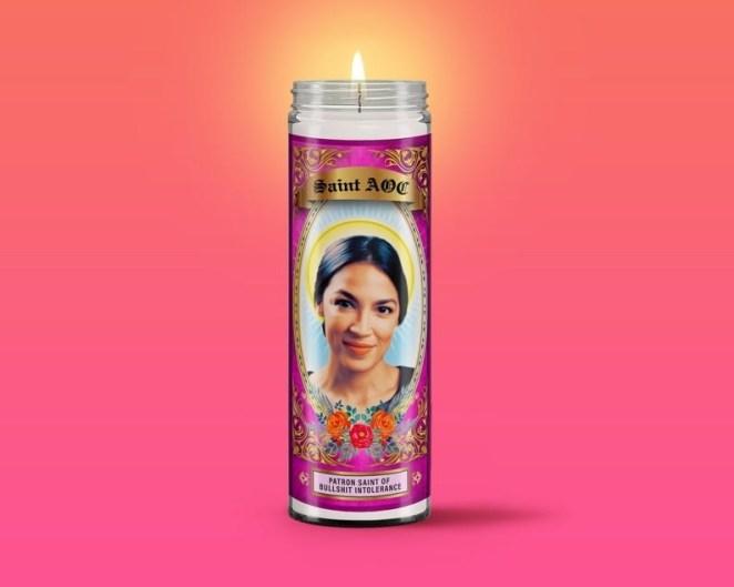 "Prayer candle with Alexandria Ocasio-Cortez's face and words ""Saint AOC: Patron Saint of Bullshit Intolerance"""