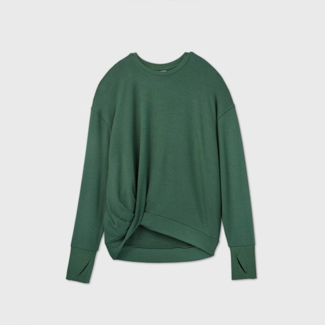 A forest green top with a twist in the front