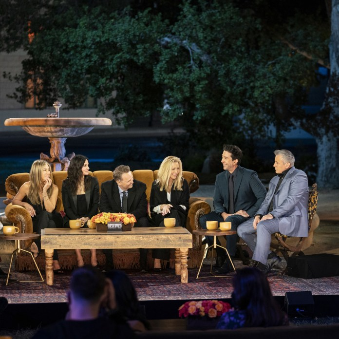 The cast of Friends sits in front of the iconic fountain during the Friends reunion