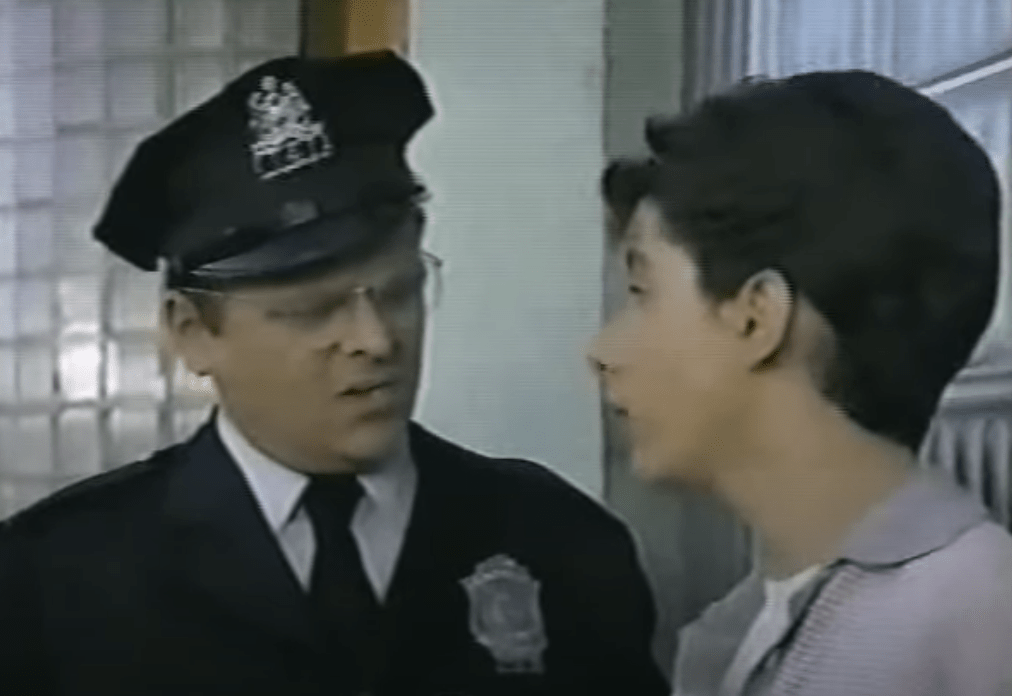 Walter as a cop talking to a kid