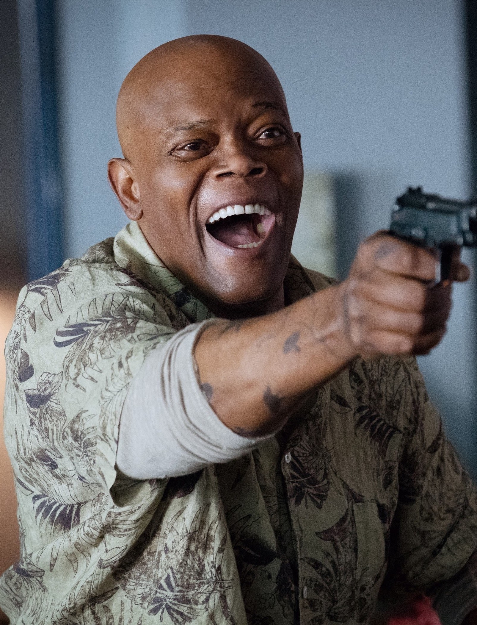 Samuel L. Jackson about to shoot someone with a gun