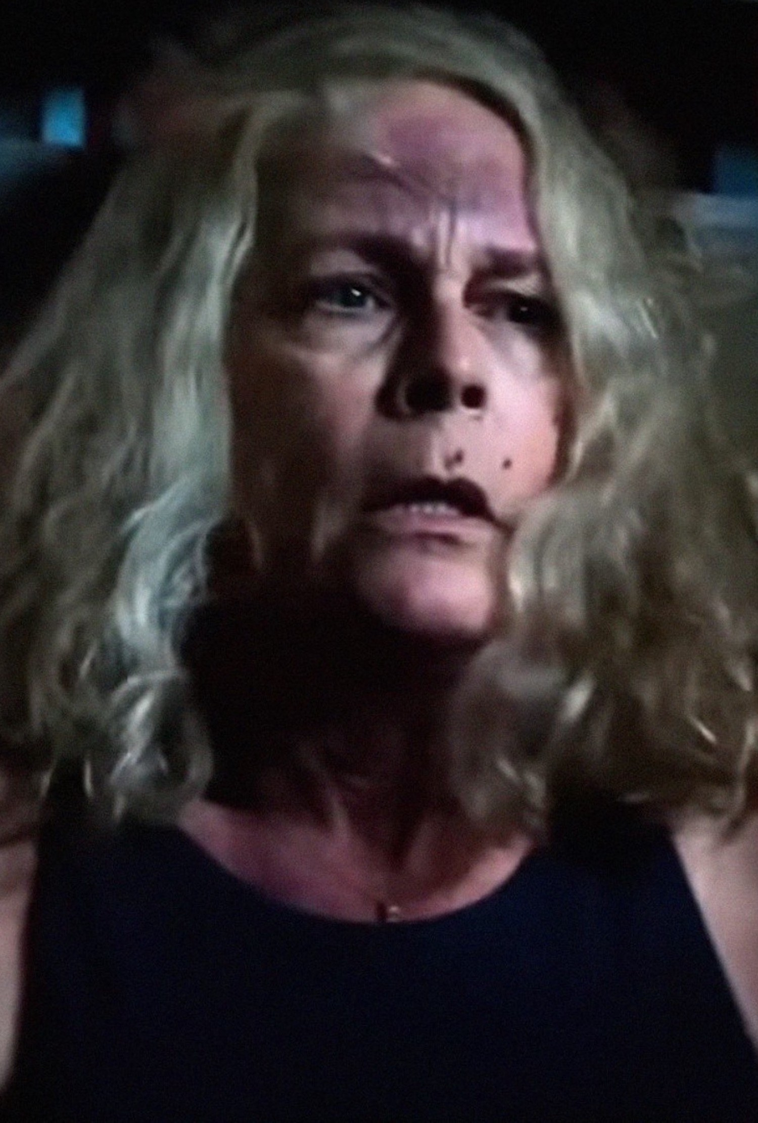 Jamie Lee Curtis scared with bloody marks all over her face