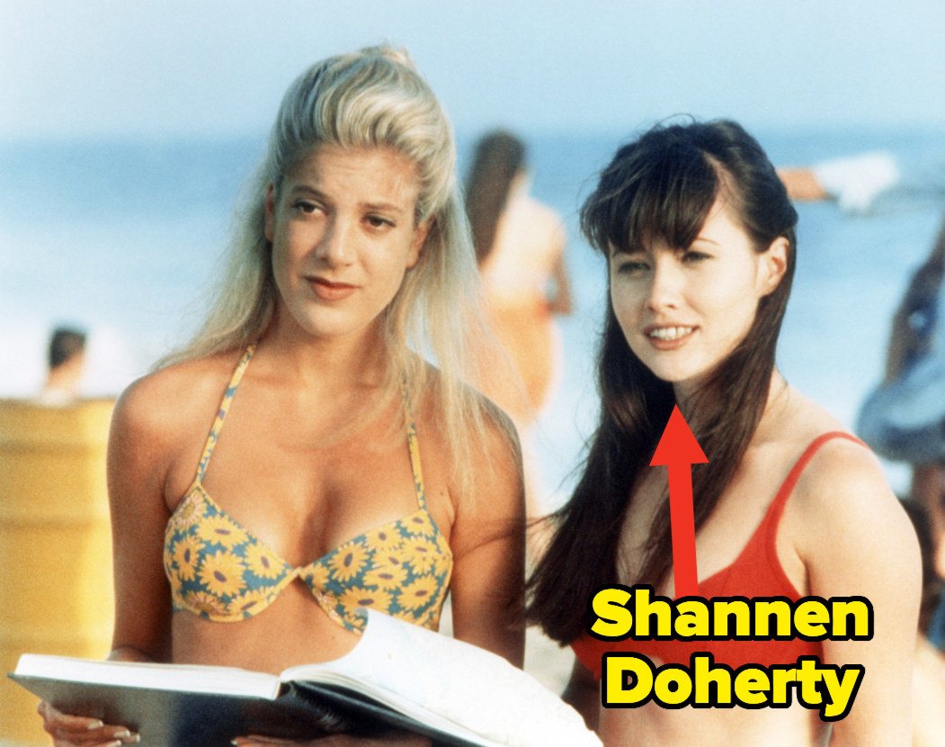 """Tori Spelling and Shannen Doherty on a beach filming """"90210"""""""