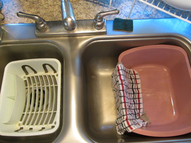 """The """"plastic bin method"""" saves time and water. Make the water temperature as high as you can stand it, and/or use rubber gloves to protect your hands."""