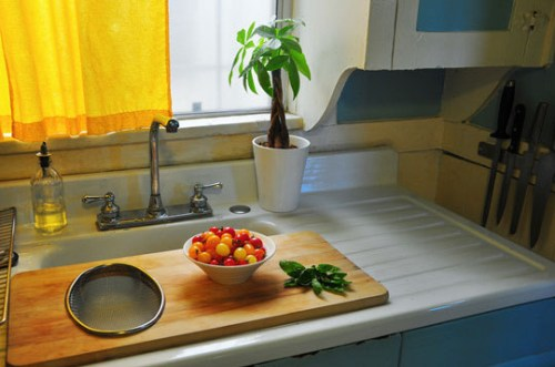 Use an over-the-sink cutting board to temporarily expand your counter space.