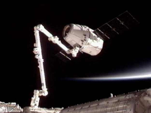 SpaceX docked its unmanned cargo craft, the Dragon, with the International Space Station. It marked the first time in history a private company had sent a craft to the station. The robotic arm of the ISS grabbed the capsule in the first of what will be many resupply trips.