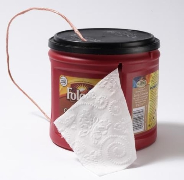 Repurpose a coffee can to hold and protect TP.