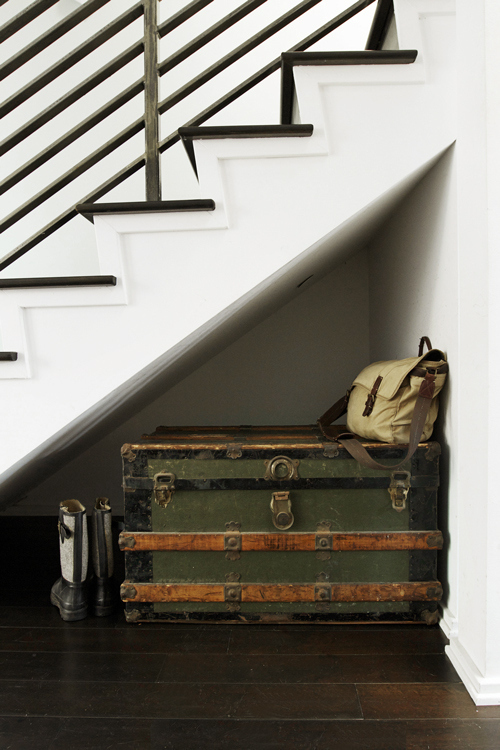Use a trunk to store out-of-season clothing or shoes, which can also double as a bench in small spaces.