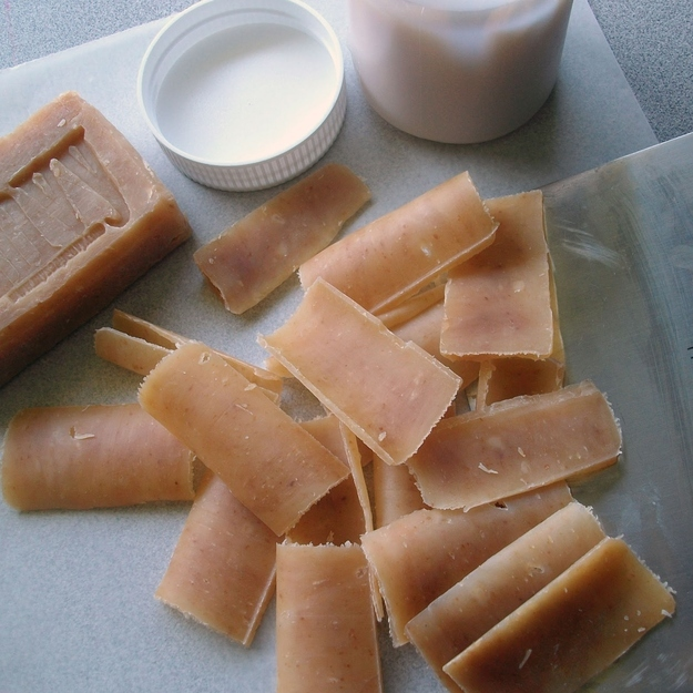 Make single-use soap leaves from a bar of soap and a vegetable peeler.
