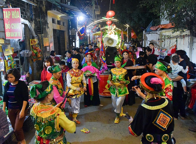 Crowds gather for pig procession festival, entertainment events, entertainment news, entertainment activities, what's on, Vietnam culture, Vietnam tradition, vn news, Vietnam beauty, news Vietnam, Vietnam news, Vietnam net news, vietnamnet news, vietnamne