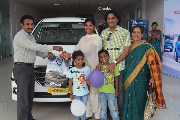 Jo my wife taking delivery of our new car - Toyota Innova. You can see my mom & kids too in the picture.