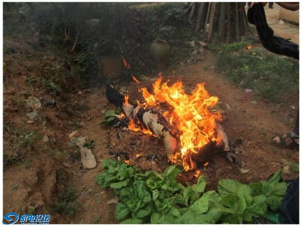 An elderly Chinese villager on fire in Hunan province.
