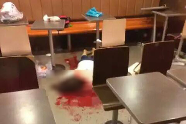 The body of a young girl who was bludgeoned to death with a metal pole inside a McDonald's in Zhaoyuan city Shandong province, China.