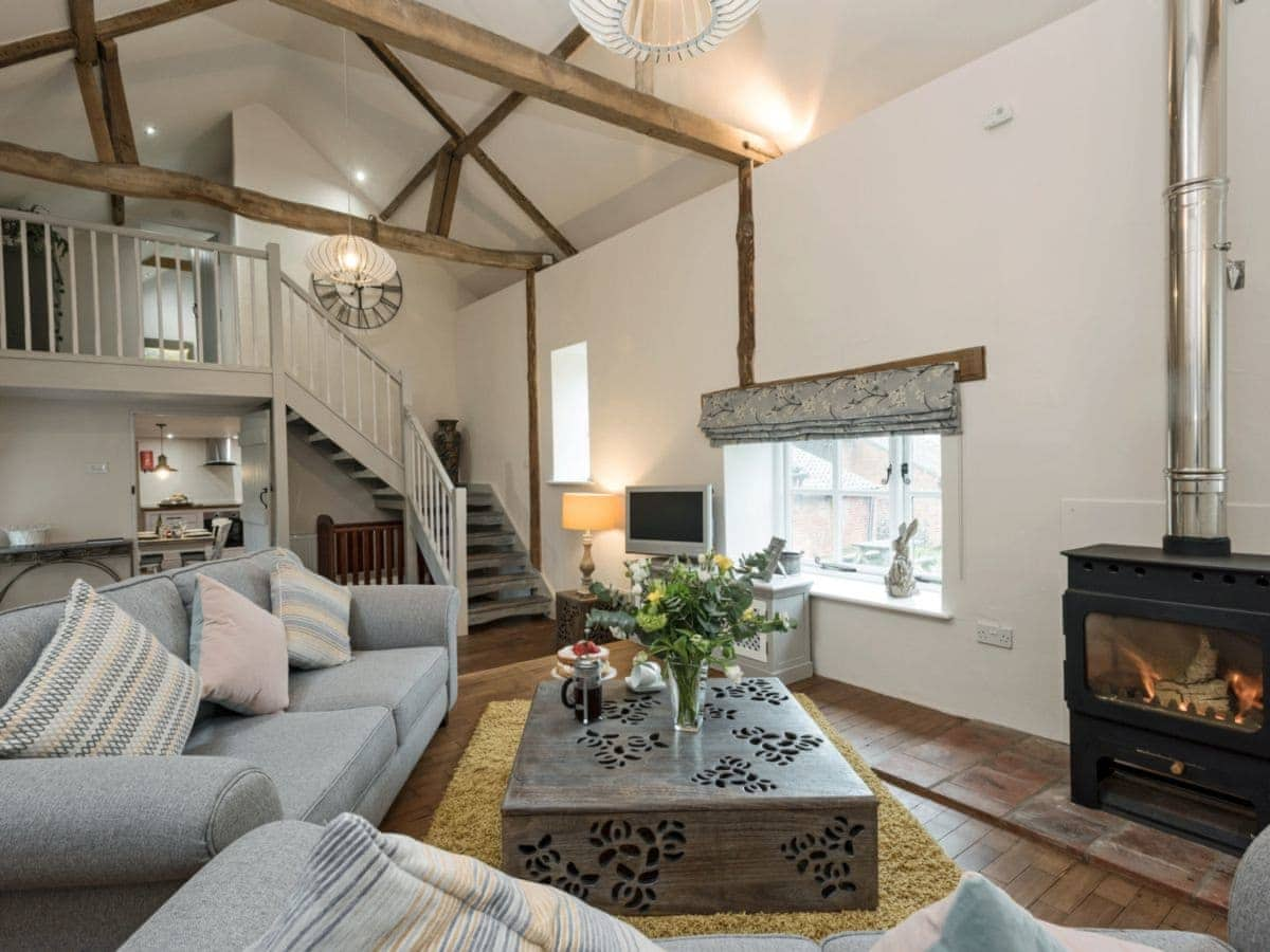 cosy living room with log burner table sets heron barn ref ukc3090 in lamas near buxton norfolk english a wooden flooring vaulted ceiling