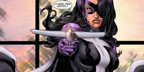 Huntress in comics with crossbow